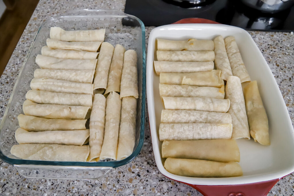Two pans of beef enchiladas
